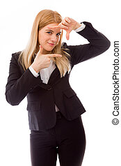Businesswoman framing face with fingers