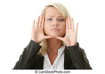 Businesswoman framing her face