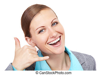 smiling businesswoman making a call me gesture, isolated over white background