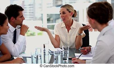 Businesswoman gesturing in front of