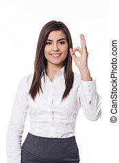Businesswoman gesturing the okay sign