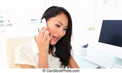 Businesswoman getting bad news on - Businesswoman getting...