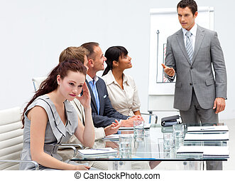 Businesswoman getting bored in a presentation