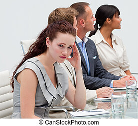 Businesswoman getting tired in a meeting
