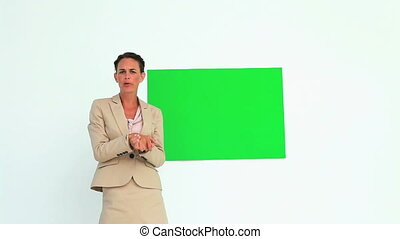 Businesswoman giving a presentation showing a poster against...