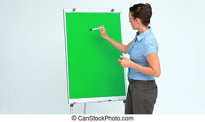 Businesswoman giving a presentation showing a board