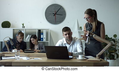 Businesswoman giving assignments to employee