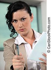 businesswoman giving her pen