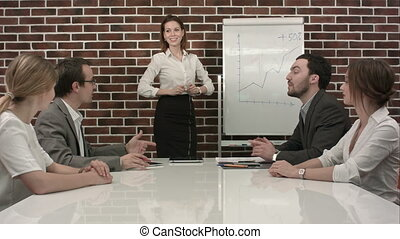 Businesswoman giving presentation on flipchart. Business...