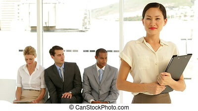 Businesswoman giving thumbs to camera at the office