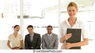 Businesswoman giving thumbs to camera in front of job...