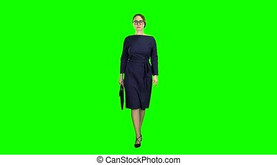 Businesswoman goes to a business meeting with a case in...