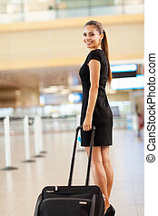 businesswoman going on business trip - attractive young...