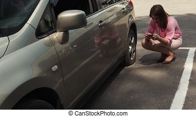 Businesswoman Got Out Of Car Checking Flat Tire