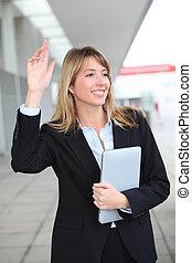 Businesswoman hailing a cab