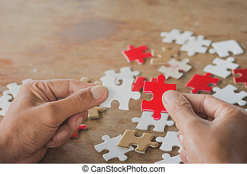 Businesswoman hand connecting jigsaw puzzle, Business solutions, success and strategy concept.