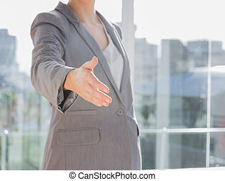 Businesswoman hand reaching out