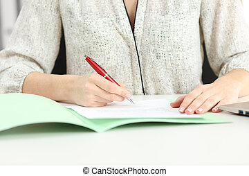 Businesswoman hand signing a contract