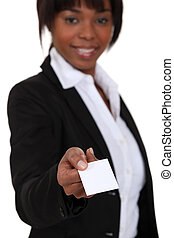 Businesswoman handing out calling card