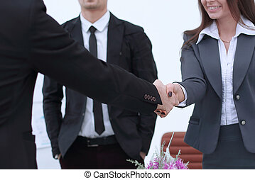 businesswoman handshake with business partner in modern office