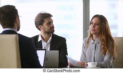 Businesswoman handshaking new male partner making deal...