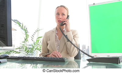 Businesswoman hanging up a phone