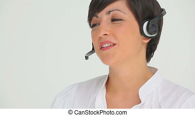 Businesswoman happily talking through a headset