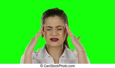 Businesswoman has headache. Green screen