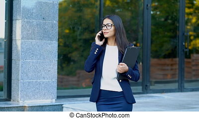 Businesswoman have conversation using mobile phone. Business...