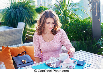 Businesswoman having a cup of coffee in cafe