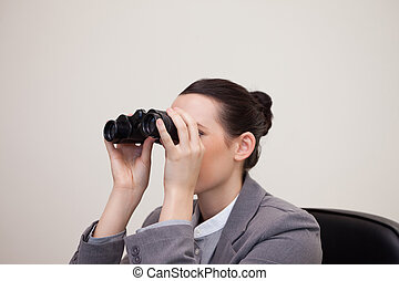 Businesswoman having a look through binoculars - Young...