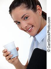 Businesswoman having a quick coffee break