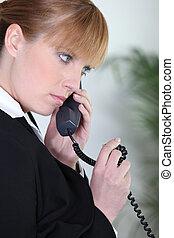 Businesswoman having a telephone conversation