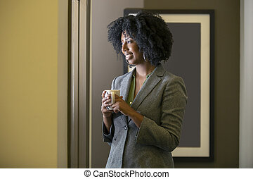 Businesswoman Having Coffee in the Office