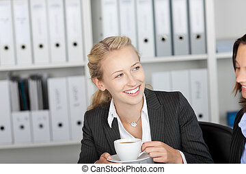 Businesswoman Having Coffee With Coworker