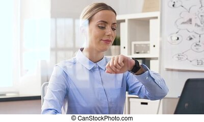 businesswoman having video call on smartwatch
