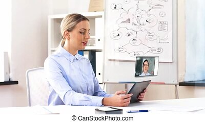 businesswoman having video call on tablet computer -...
