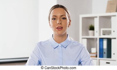 businesswoman having video conference at office