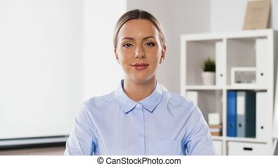 businesswoman having video conference at office - business,...