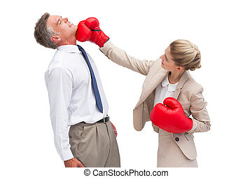 Businesswoman hitting her co worker - A businesswoman...