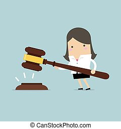 Businesswoman hold a big gavel in hands for justice.