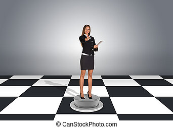 Businesswoman hold folder and pointing finger at camera