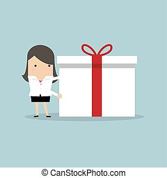 Businesswoman holding a big gift box for Christmas festival.
