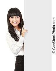 Businesswoman holding a blank presentation board