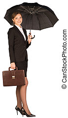 Businesswoman holding a briefcase and umbrella