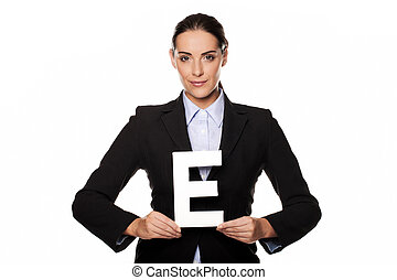 Businesswoman holding a capital letter E