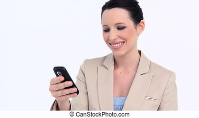 Businesswoman holding a cellphone against white background