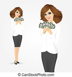 businesswoman holding a fan of money