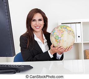 Businesswoman Holding a Globe