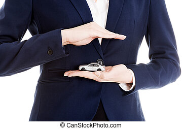 Businesswoman holding a model of car